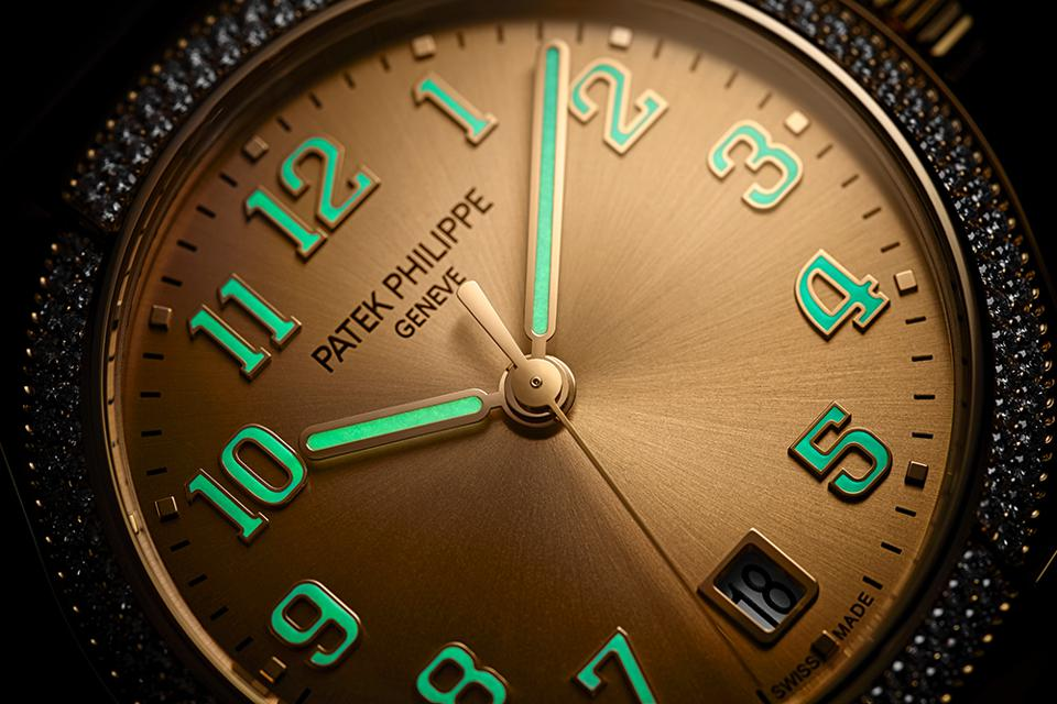 The 18k gold numerals on the dial of the Patek Philippe Twenty-4 Automatic are coated with Super-LumiNova.