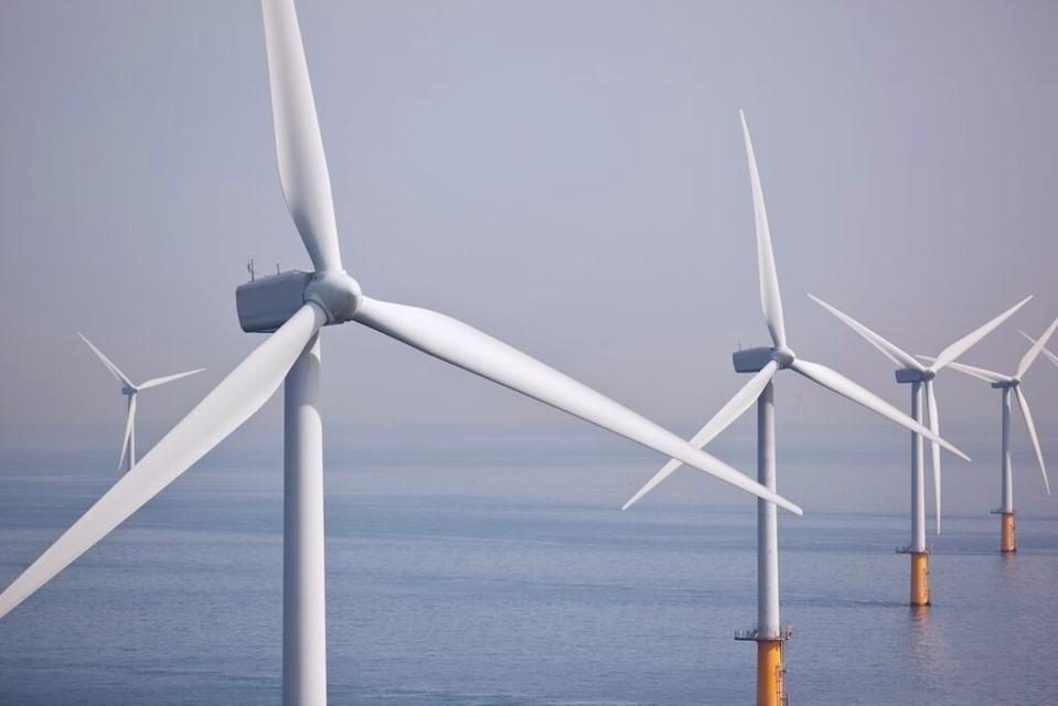 Photo of wind turbines at sea.