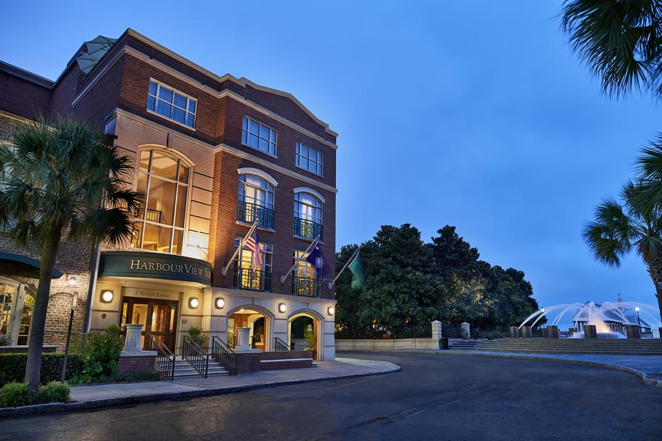 The exterior of HarbourView Inn at sunset.