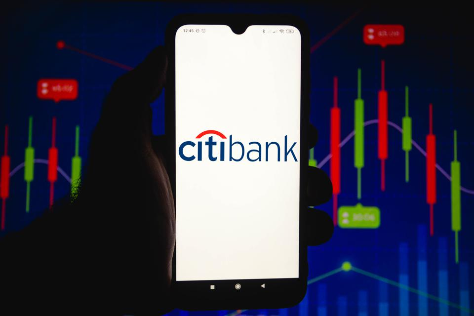 In this photo illustration the Citibank logo seen displayed...
