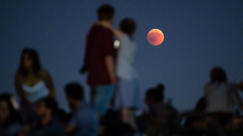 During a total lunar eclipse the Moon dives into the Earth's shadow. Photo: Matthias Balk/dpa (Photo by Matthias Balk/picture alliance via Getty Images)