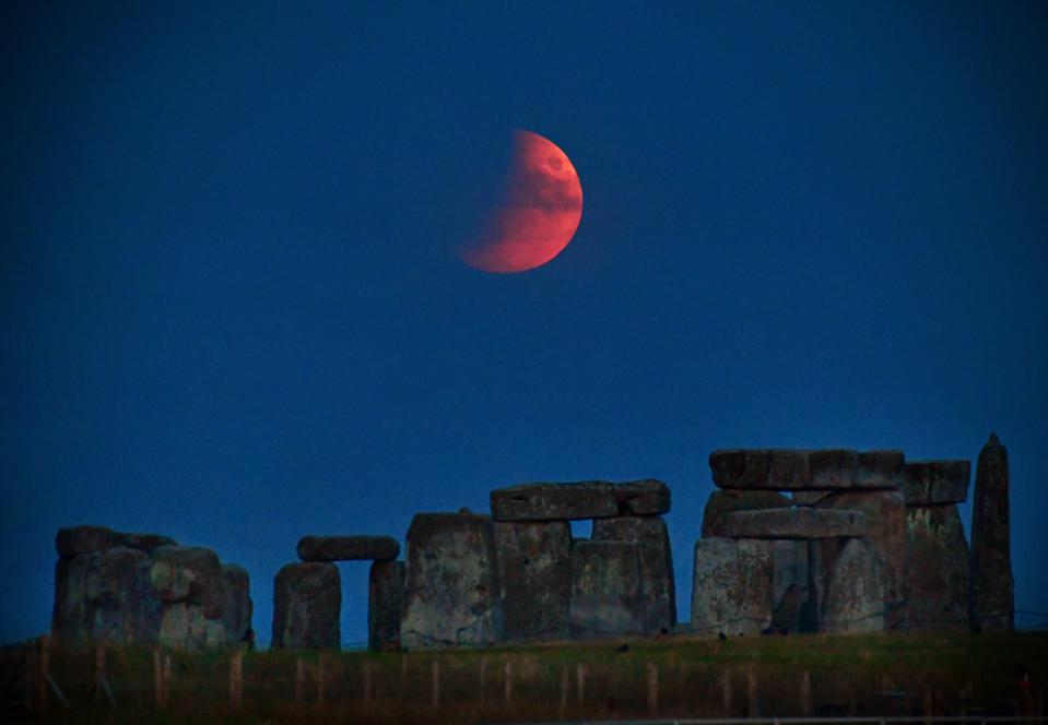 Partial lunar eclipse rising over Stonehenge, UK, on July 16th 2019