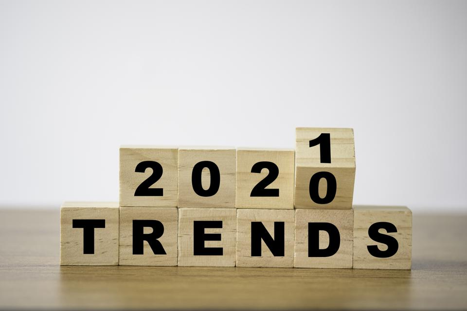 flipping 2020 to 2021 trends print screen on wooden block cubes. New idea business fashion popular and relevant topics.