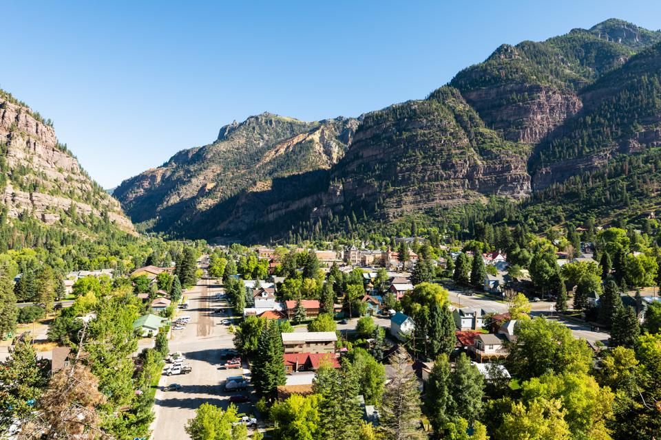 Ouray high angle aerial view of small town in Colorado with city main street historic architecture
