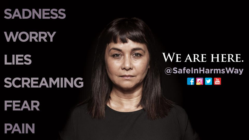A women faces the camera against a black background in an ad for Safe In Harm's Way.