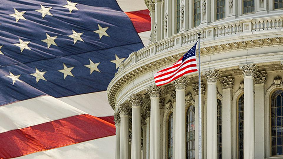 Photo of Capitol Building and American Flag