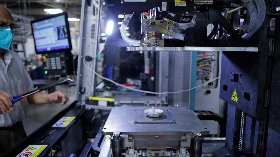 A technician works on the Xerox metal 3D printer.