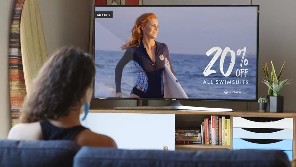 Woman watches digital ad on TV