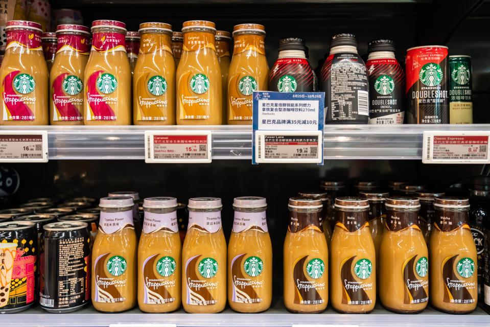 Bottles of Starbucks drinks in a display case.