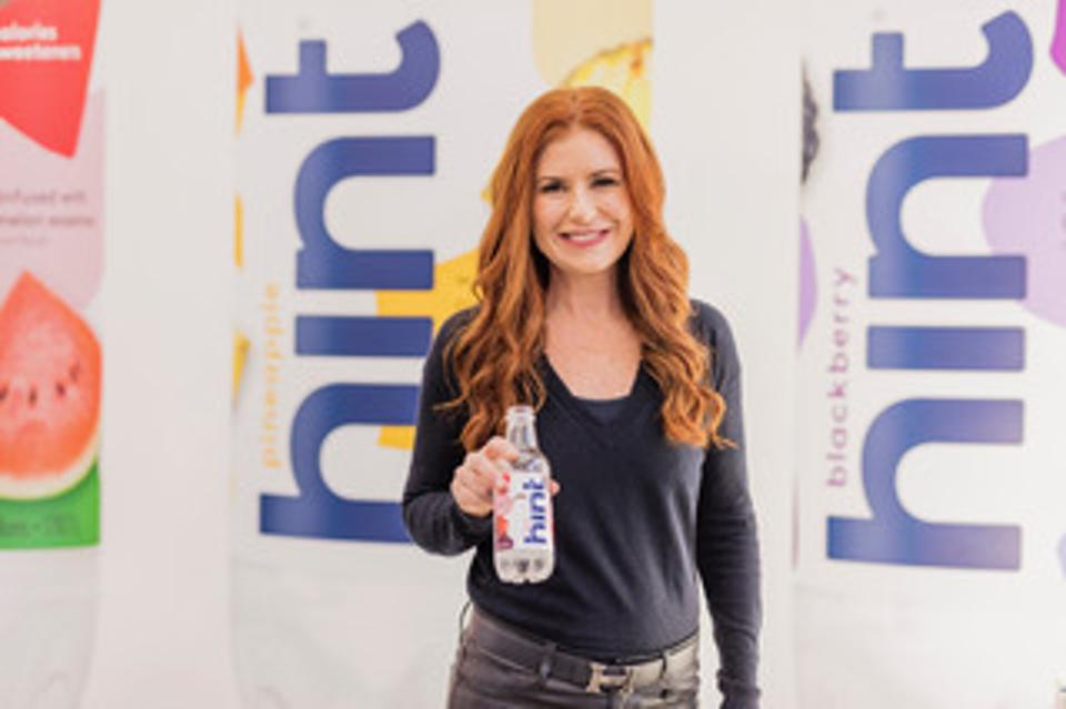 Kara Goldin holds a bottle of Hint Water.