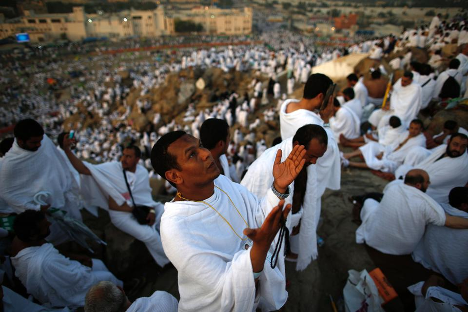 Muslim pilgrims join one of the Hajj rituals on Mount Arafat near Mecca (AHMAD GHARABLI/AFP/Getty Images)