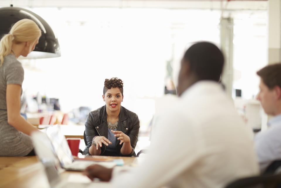Creative business people having meeting in office