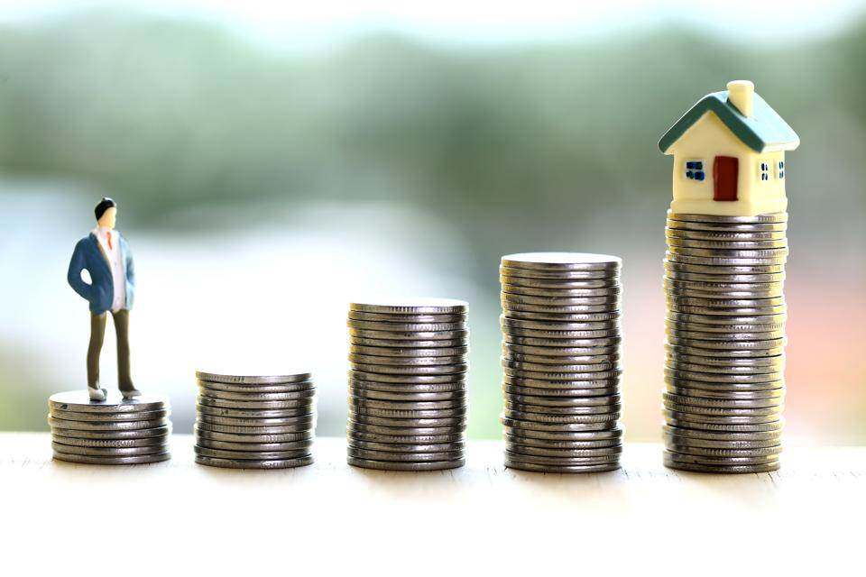 Concept of money savings and own house purchase-Stack of coins