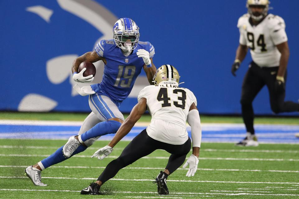 DETROIT, MICHIGAN - OCTOBER 04: Kenny Golladay #19 of the Detroit Lions tries to get around the tackle of Marcus Williams #43 of the New Orleans Saints at Ford Field on October 04, 2020 in Detroit, Michigan. New Orleans won the game 35-29. (Photo by Gregory Shamus/Getty Images)
