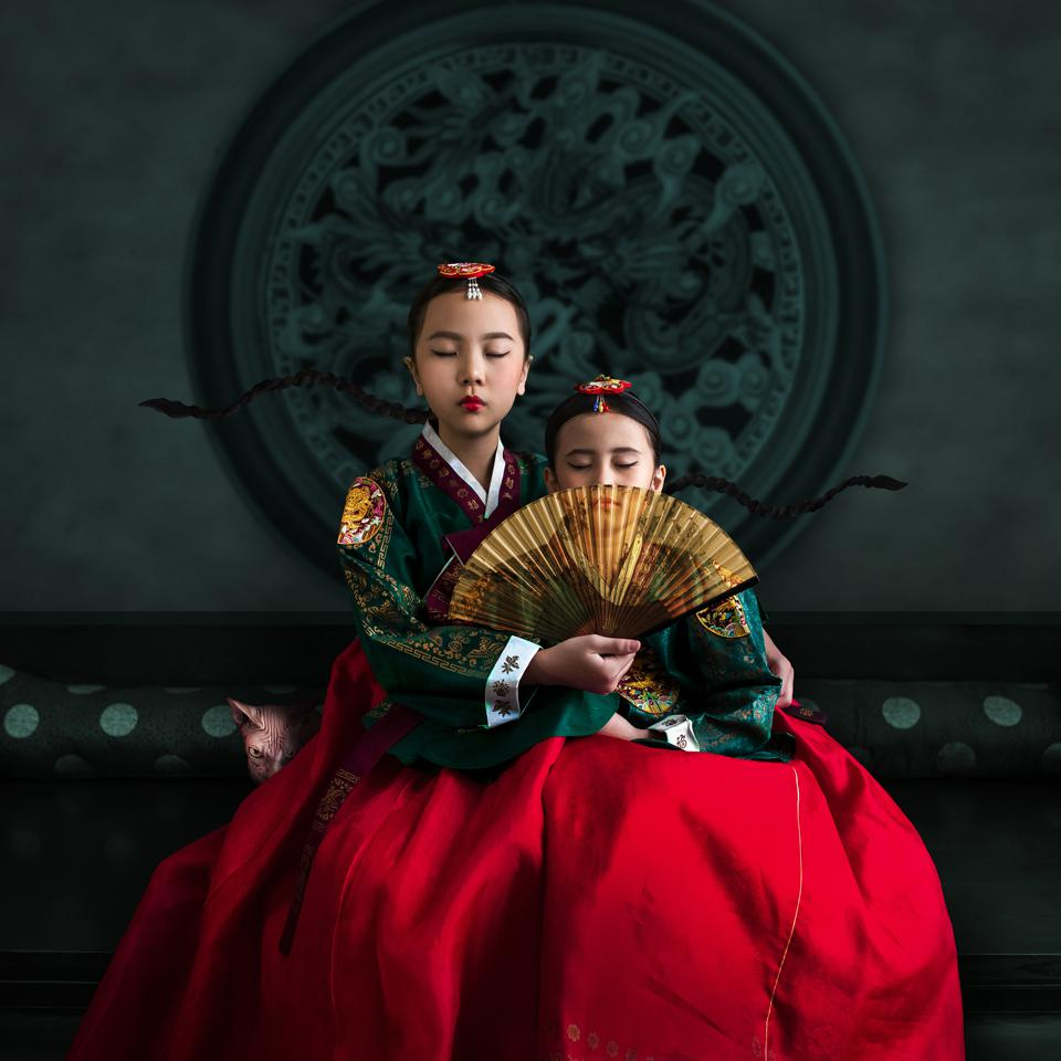 Sony World Photography Awards winning photo of two girls in traditional Indonesian clothes.