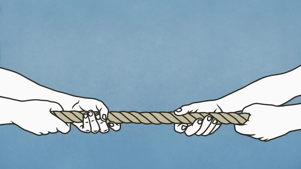 Two sets of hands playing tug-of-war with rope