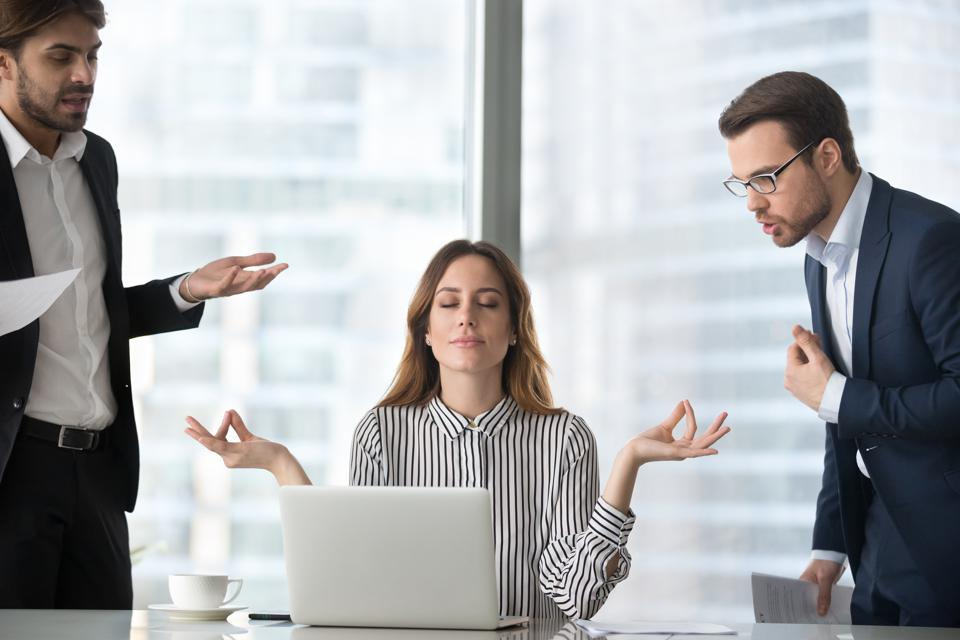 Calm female managing stress at workplace not involved in fights
