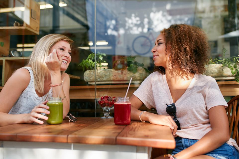 Two female friend having a chat in cafe