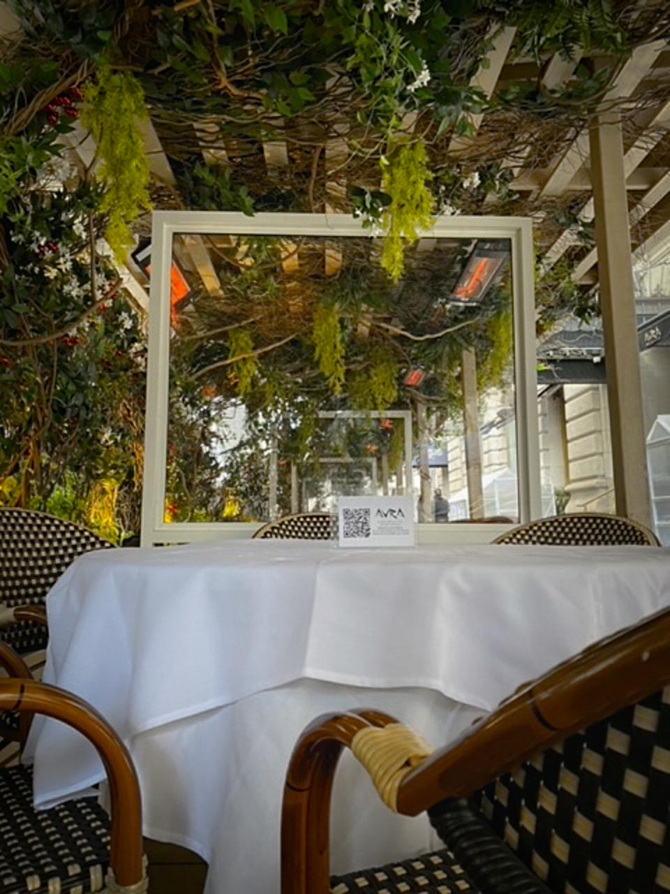 Greek favorite Avra has installed charming plant-filled shelters as well as greenhouses which completely protect patrons from the elements.