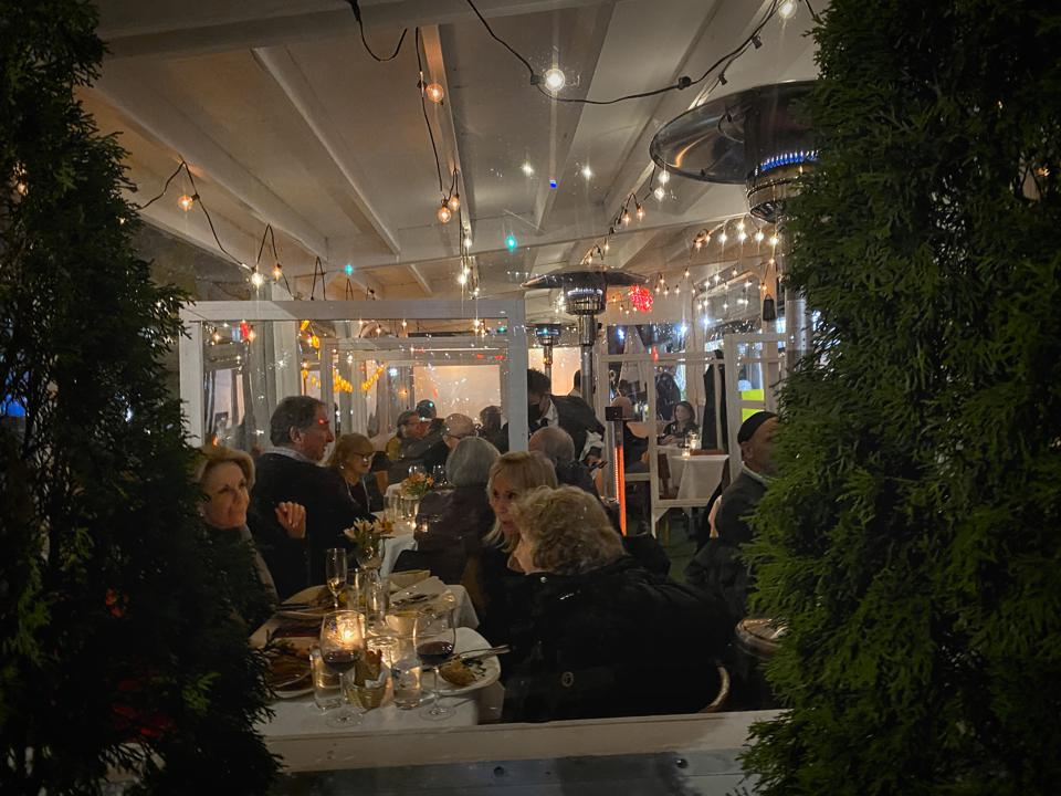 The popular Upper East Side Italian spot achieves a festive feel and social buzz in its outdoor dining shelter.