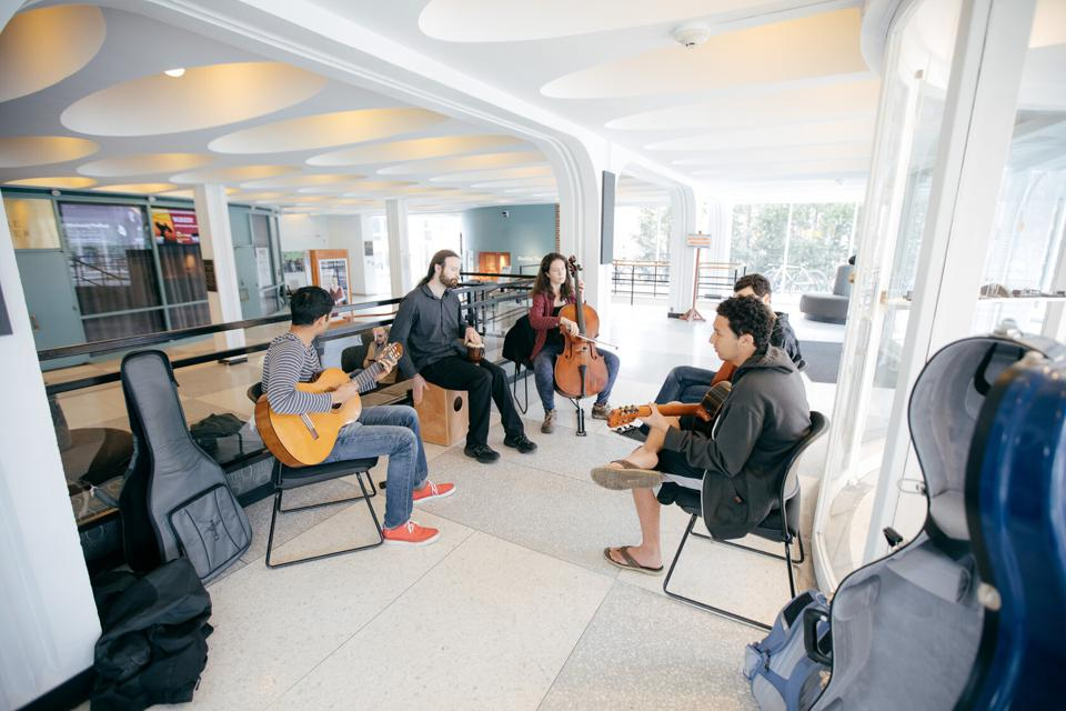 Musicians practicing inside the Hopkins Center for the Arts at Dartmouth College.