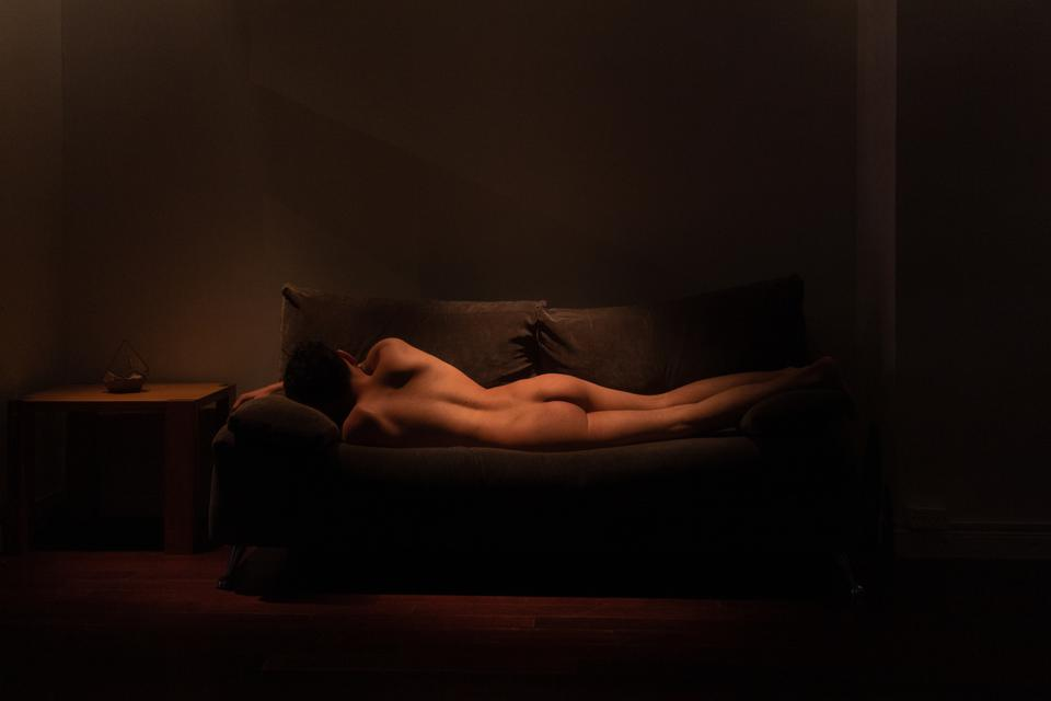 Sony World Photography Awards winning photo of naked model laying on a sofa.