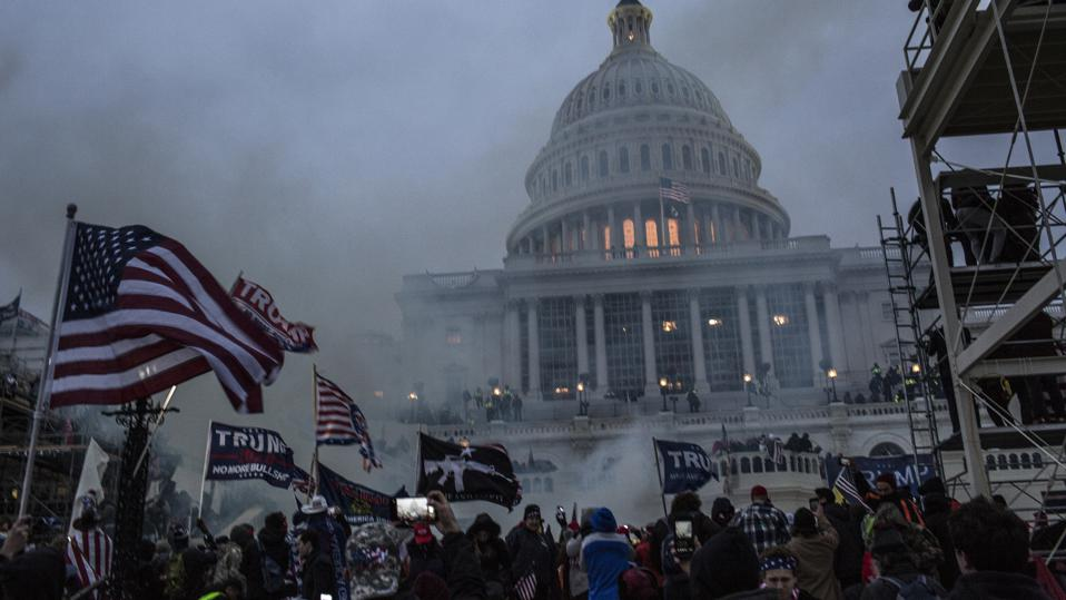 Security forces respond with tear gas after the US President...
