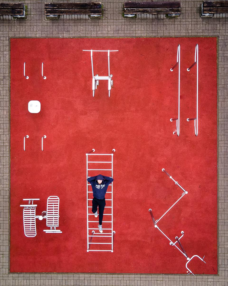 Sony World Photography Awards winning photo  of a person at a gym with red floors taken from above