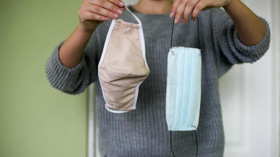 Disposable medical protective mask and reusable cotton protective mask flat lay.