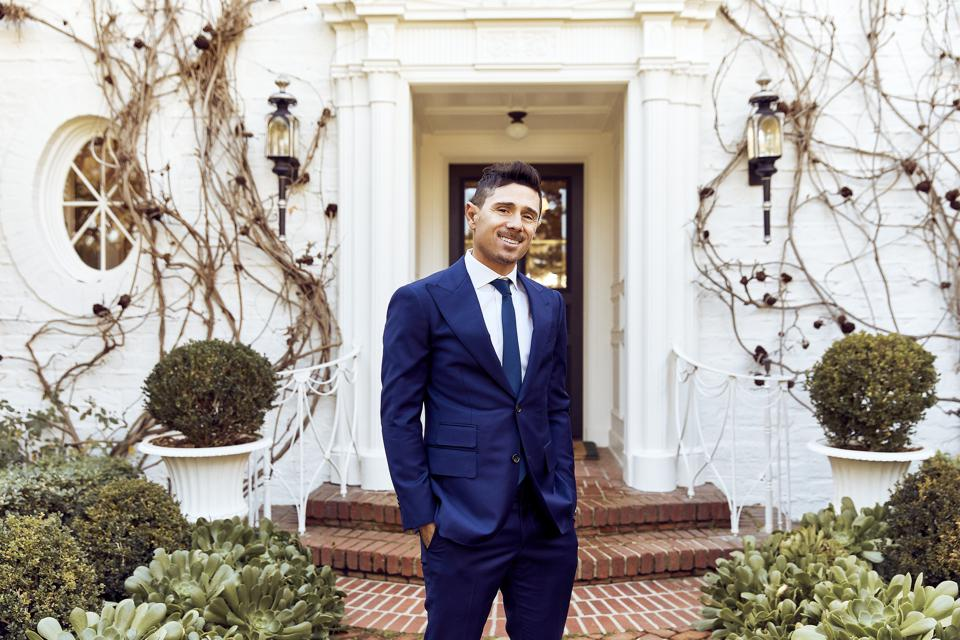 luxury real estate agent bjorn farrugia in front of mansion