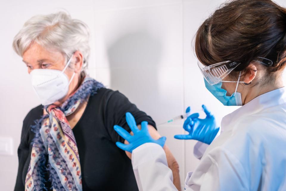 A senior getting a Covid vaccine