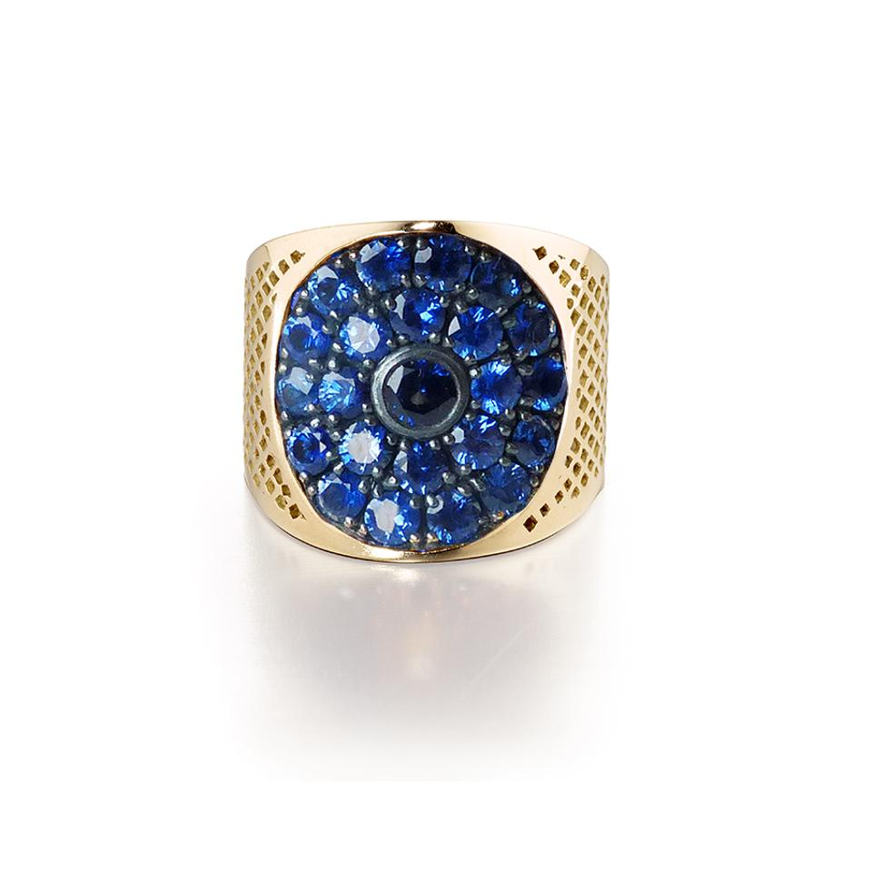 Celestial blue sapphires animate a wide 18-karat gold Crownwork® band by Ray Griffiths.