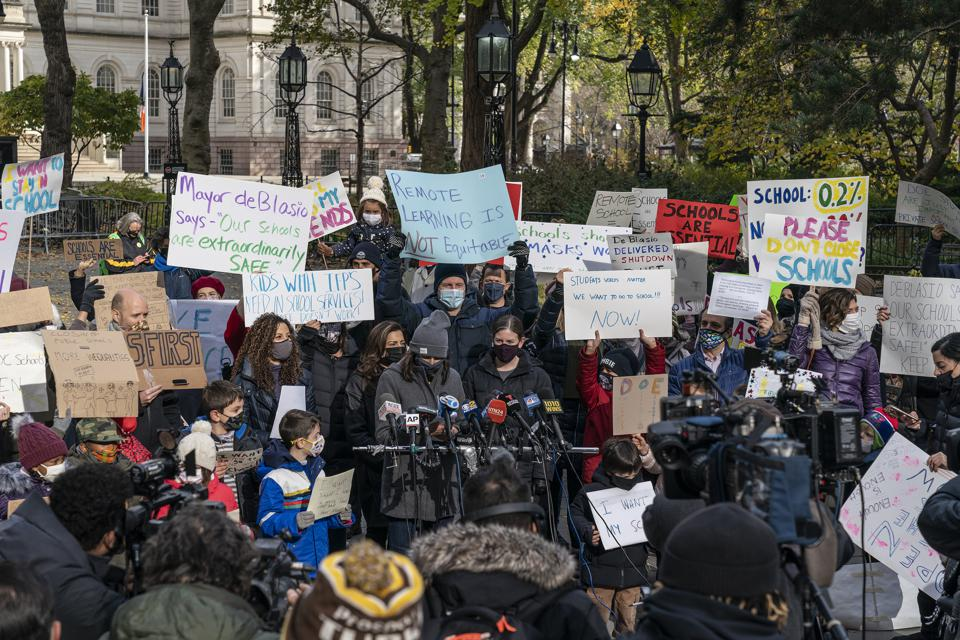 Frustrated parents and their children rally against Mayor's...