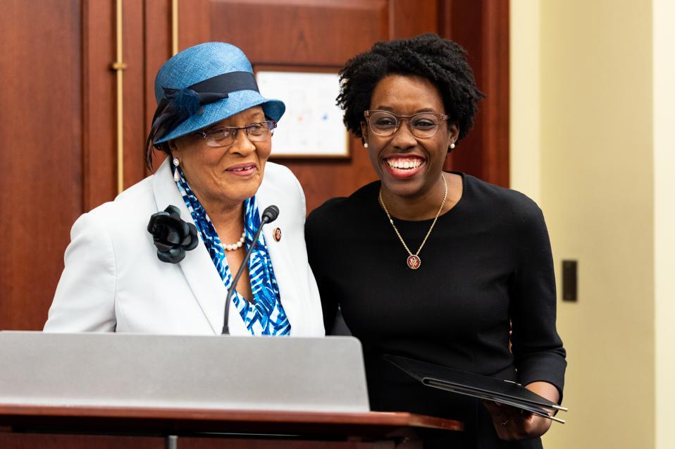 U.S. Representatives Alma Adams (D-NC) and Lauren Underwood...