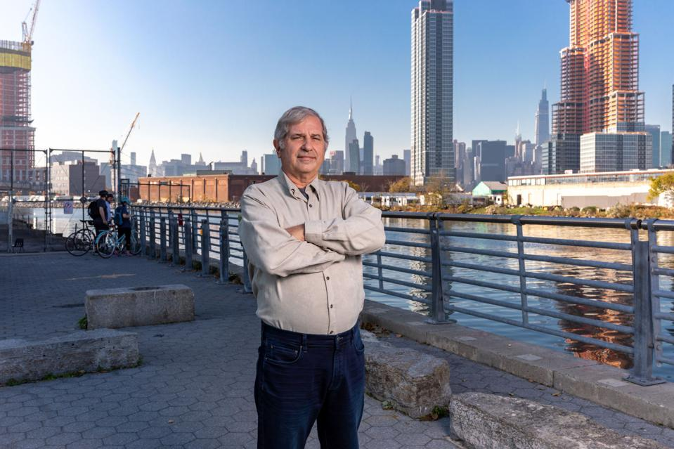 Man stands with New York City skyline behind