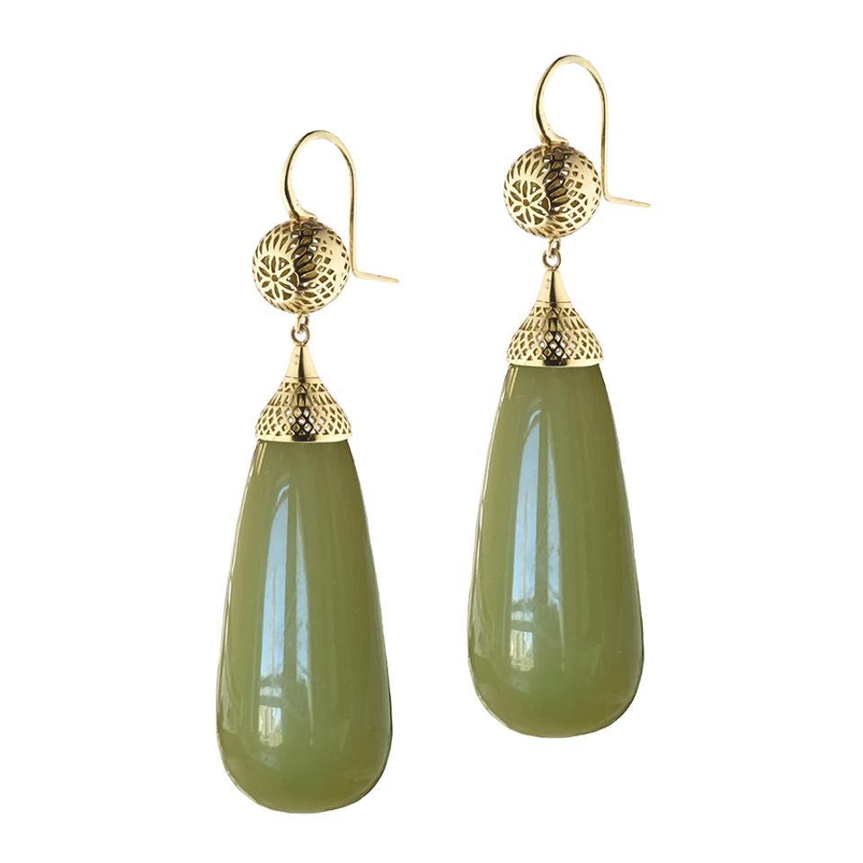 Teardrop-shaped, green amber pendant earrings by Ray Griffiths