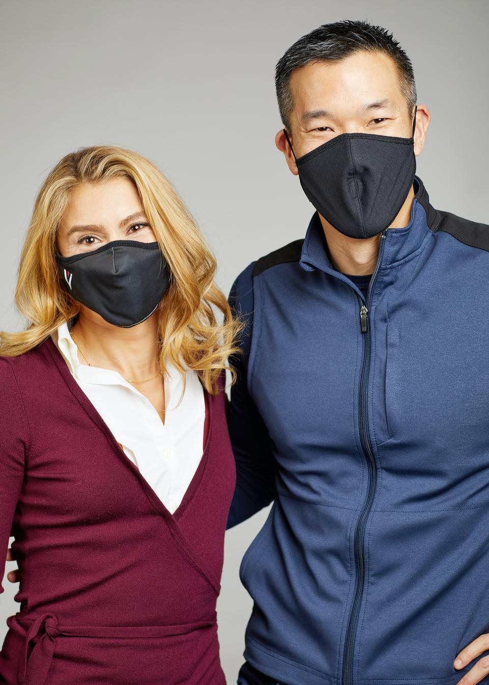 Jennifer Fleiss and Larry Cheng of Volition capital wearing masks and facing the camera