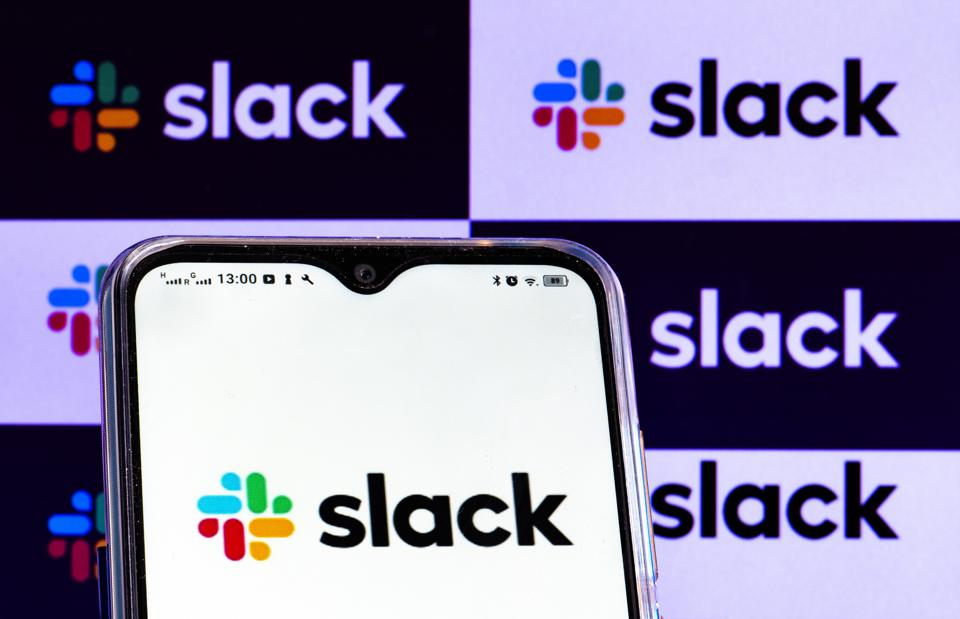 In this photo illustration a Slack Technologies Inc. logo is...