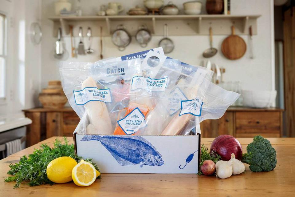 a box filled with the best frozen seafood straight from Alaskan fishermen
