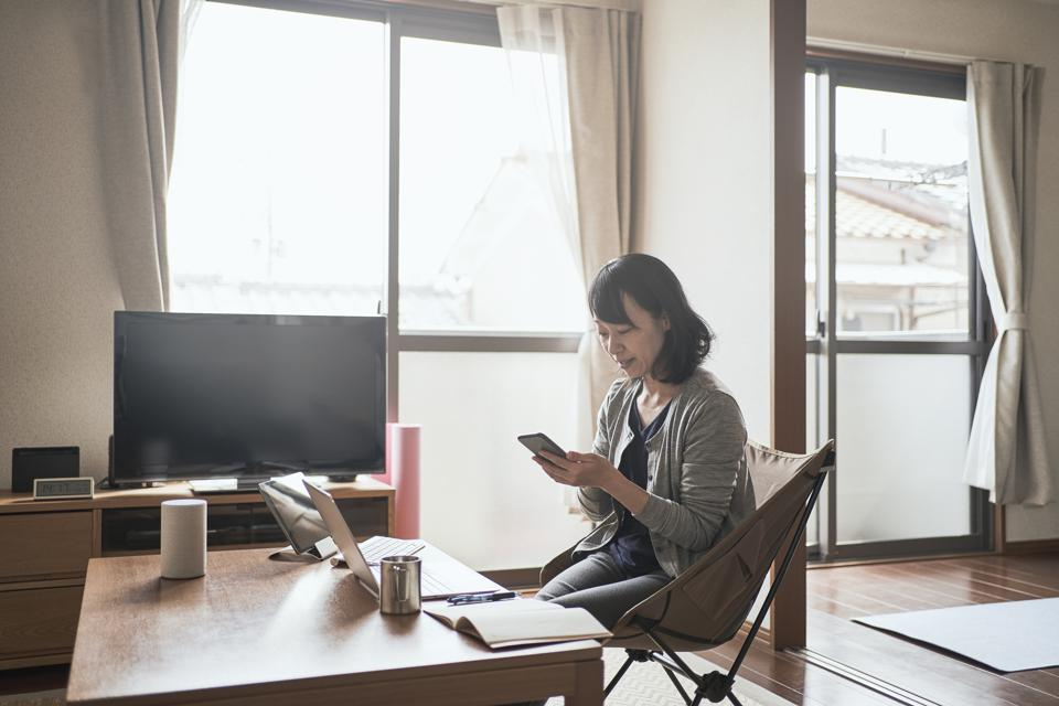 Asian female worker working from Home.