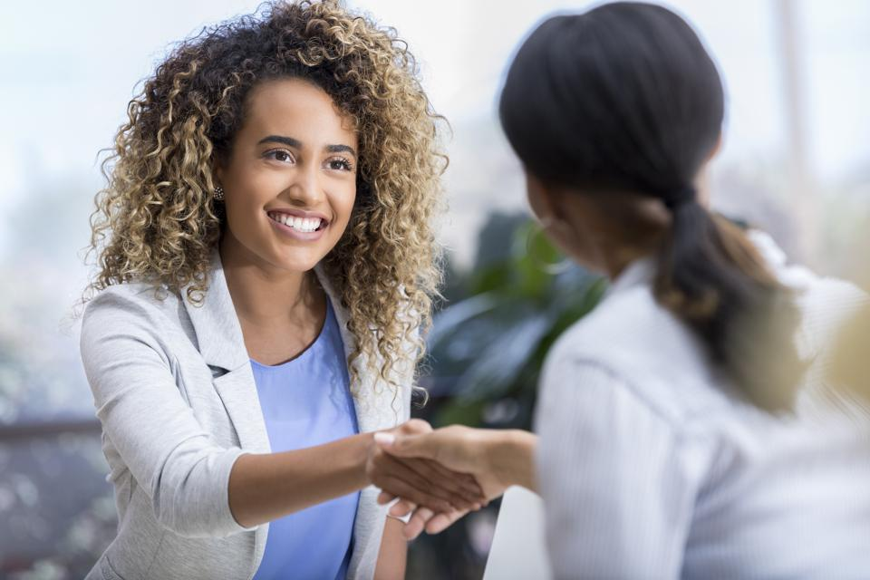Young woman enjoys meeting new therapist
