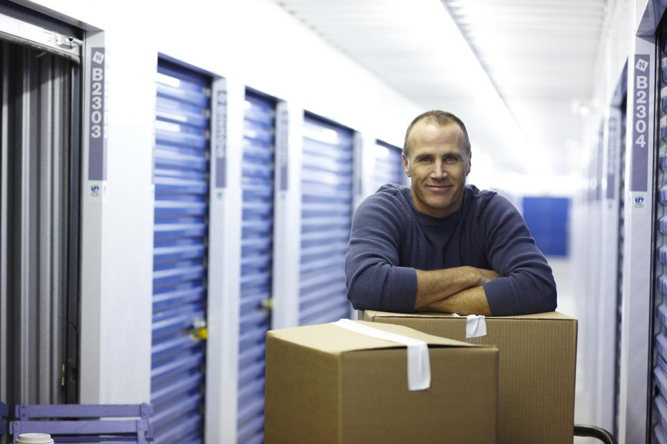 Man with boxes in a storage facility