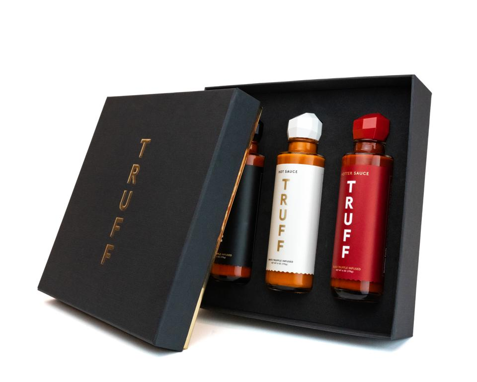 A three-pack gift box of Truff's signature, truffle-infused hot sauces
