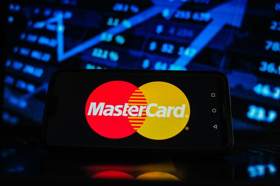 In this photo illustration a Mastercard logo seen displayed...