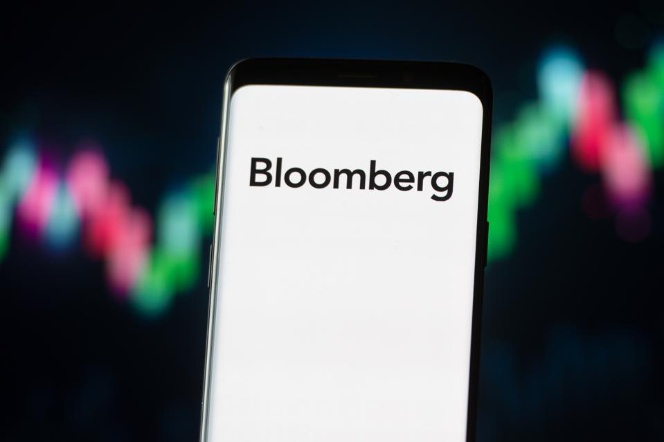In this photo illustration a Bloomberg logo seen displayed...