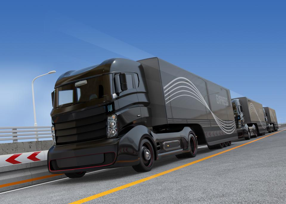 Fleet of autonomous hybrid trucks driving on highway