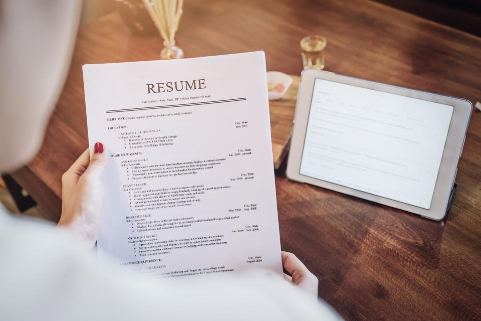 woman reading a resume