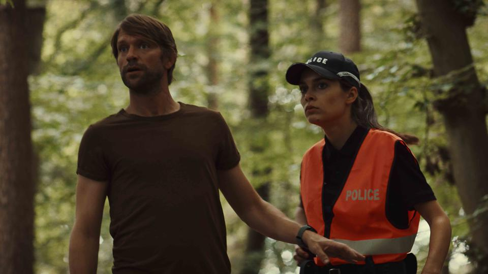 Luc Schiltz as Capitani and Sophie Mousel as officer Elsa Ley in 'Capitani' on Netflix