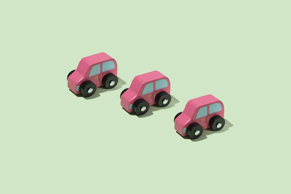 three toy cars on a green background