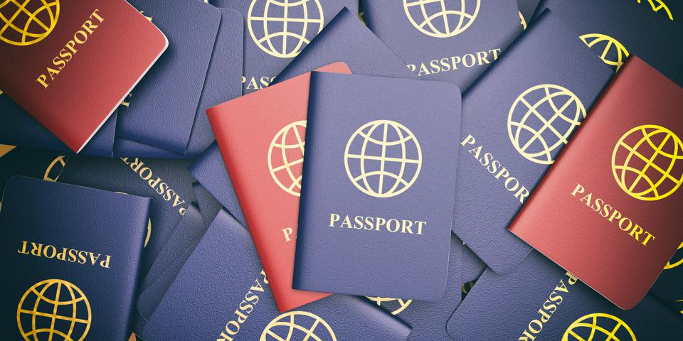 Blue and red passports background. 3d illustration